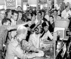 SPECIAL TO THE SPOKESMAN REVIEW--FILE--Whites pour sugar, ketchup and mustard over heads of sit-in demonstrators at a restaurant lunch counter in Jackson, Mississippi June 12,1963. (AP Photo/Jackson Daily News /Fred Blackwell)